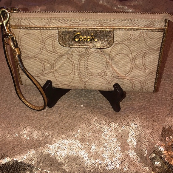 Coach Handbags - Gently used Coach large wristlet!